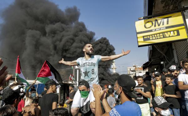Protesters block the main road outside the Palestinian refugee camp of Burj al-Barajneh, south of the Lebanese capital Beirut, on July 16. The protests are against Lebanese government decision to restrict Palestinians' work opportunities.