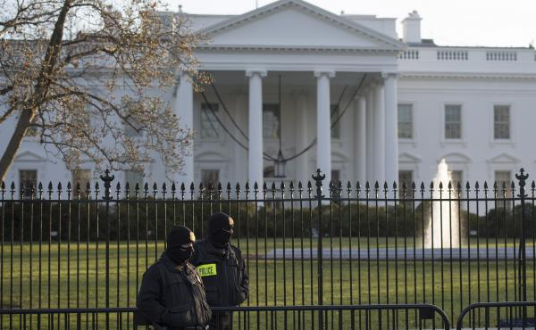 A review panel says changes are needed at the Secret Service — along with a better fence at the White House. Here, members of the Secret Service Uniformed Division stand in front of the White House.