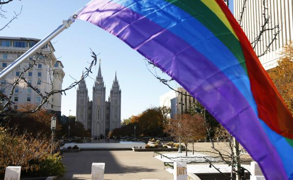 The Church of Jesus Christ of Latter-day Saints announced Thursday that it will no longer consider people in same-sex marriages to be apostates. Here, a pride flag flies in front of the Historic Mormon Temple in Salt Lake City as part of a 2015 protest of