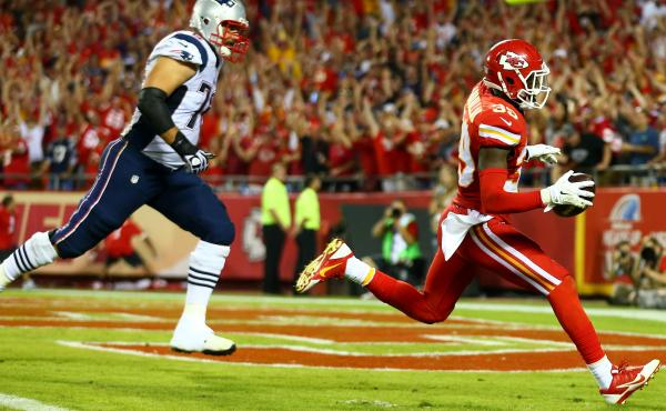 Husain Abdullah of the Kansas City Chiefs scores a touchdown after an interception against the New England Patriots Monday. He was then penalized for praying on his knees — something the NFL now says shouldn't have been punished.