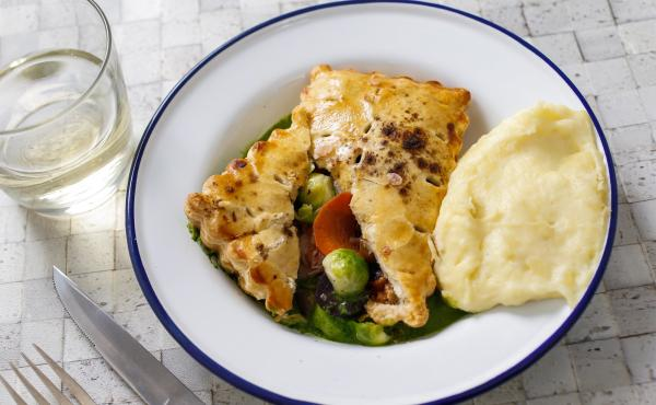 For Barrow Street Theatre, pie shells are baked and filled with the chicken and vegetables, cooked in a little white truffle butter, then sprinkled with truffle zest.