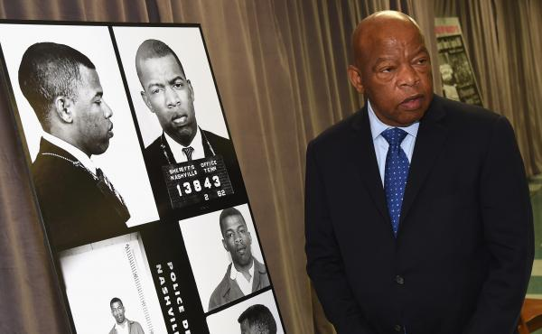 Rep. John Lewis views for the first time images and his arrest record for leading a nonviolent sit-in at Nashville's segregated lunch counters in 1963.