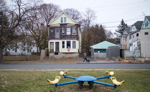 Vacant homes marked as unsafe structures in the West Hill neighborhood of Albany, N.Y. New data from the Institute for Child, Youth and Family Policy at Brandeis University reveal a sharp racial divide in access to opportunities in almost every major metr