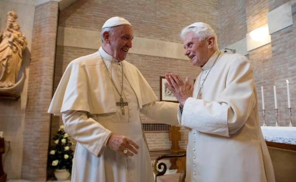 Pope Francis (left) talks with Pope Emeritus Benedict XVI in the former Convent Mater Ecclesiae at the Vatican in 2016, three years after Benedict stunned the Catholic Church by resigning to become pope emeritus.