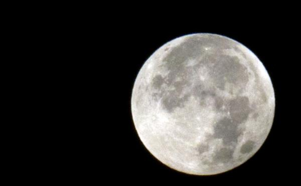 A supermoon appears above Antwerp, Belgium, on Sept. 28, 2015. Andy Weir's second novel takes place on the first human colony on the moon.