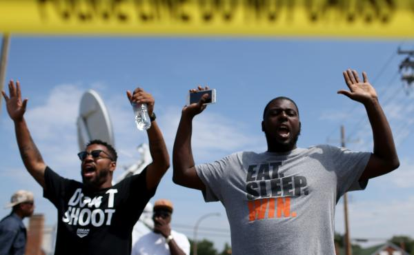 "The shooting of Michael Brown in Ferguson, Mo., also led to a series of protests. Many of them, like this protest on Aug. 19, featured people raising their arms and chanting, ""Hands up, don't shoot."" But interactions between police and protesters were mor"