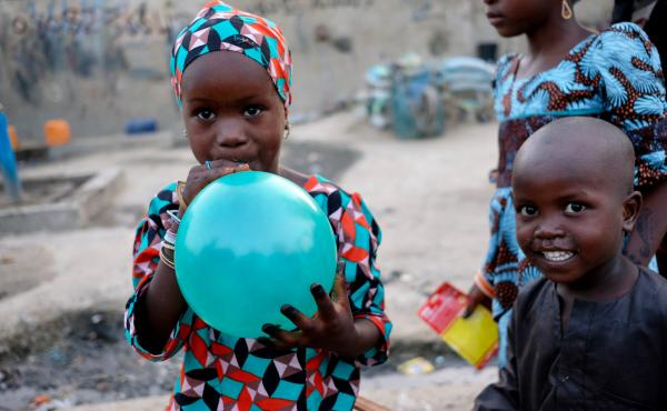 Five-year-old Fatima shows off her Sallah gift in a camp for those internally displaced by the ongoing violence in Maiduguri, the capital of Borno State in northeast Nigeria.