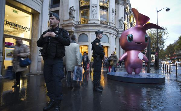French gendarmes patrol outside the Printemps department store in Paris, a city that's still on edge and on a security alert after last week's deadly terrorist attack.