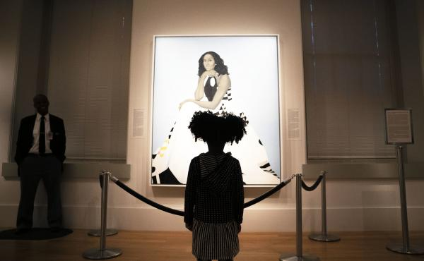 Parker Curry, 4, takes in Amy Sherald's painting of Michelle Obama in the National Portrait Gallery in Washington, D.C. Parker has co-authored a book with her mom called Parker Looks Up: An Extraordinary Moment.