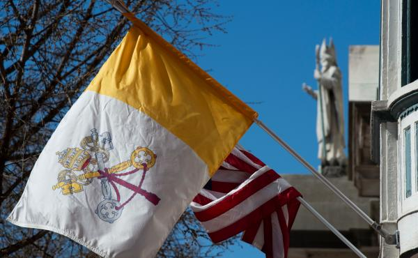 The U.S. flag and flag of Vatican City are hung on the outside of the Pennsylvania Catholic Conference building in Harrisburg, Pa., on March 26, 2019. Catholics outnumber Evangelicals in Pennsylvania by a 2-to-1 margin.