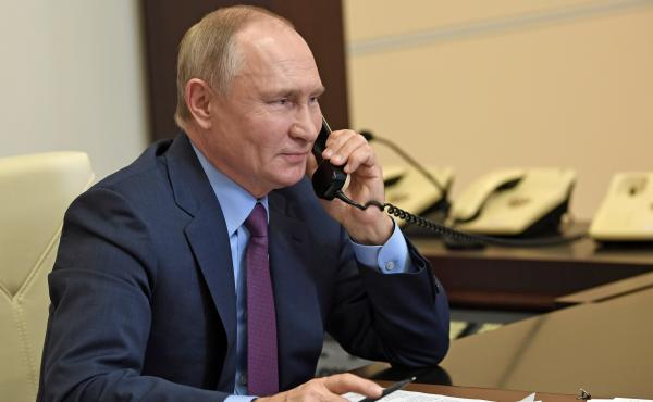 Russian President Vladimir Putin speaks on the phone last month. Putin and President Biden discussed several tense issues facing the two countries in a phone call Tuesday.