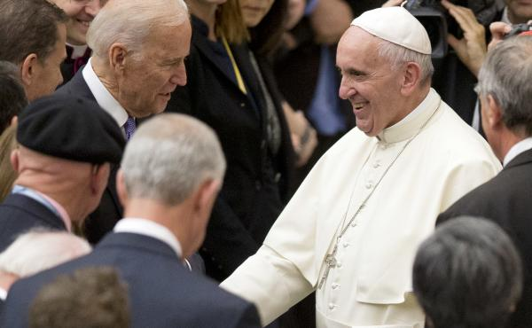 Pope Francis shakes hands with Joe Biden, then vice president, at the Vatican, in 2016.