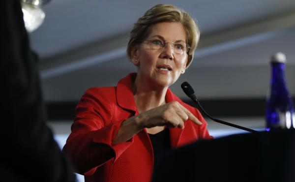Sen. Elizabeth Warren, D-Mass., speaks Tuesday at the National Press Club in Washington, where she delivered a speech on the need for stronger laws limiting corruption. It's an argument against the Trump administration that could be used if she runs again
