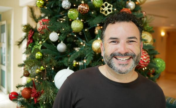 Puerto Rican merengue singer Joseph Fonseca says he wrote a holiday song about generators to bring joy to people suffering through a long hurricane recovery that has left thousands dependent on generators for power.