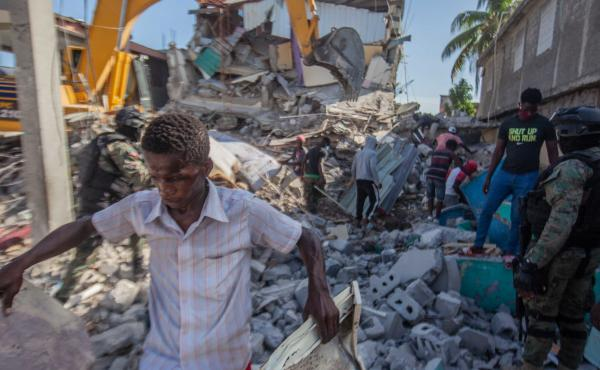 Haitians in Les Cayes assess the damage on Sunday after a 7.2-magnitude earthquake struck Haiti.