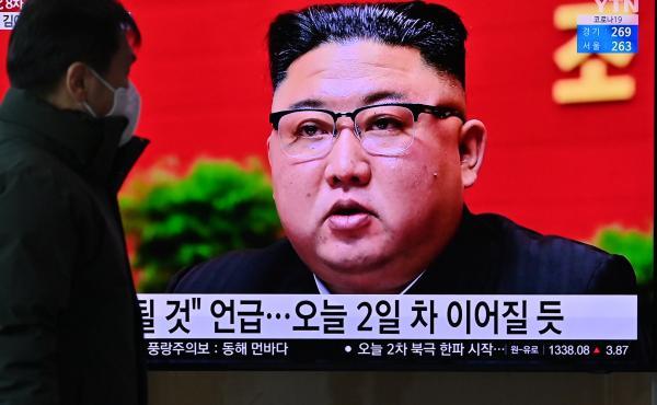 A man watches a television screen at a railway station in Seoul on Wednesday showing news footage of North Korean leader Kim Jong Un attending the 8th Congress of the ruling Workers' Party held in Pyongyang.