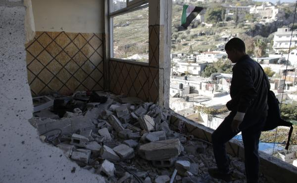 After Palestinian Abdel Rahman Shaludi killed two people with a car in an attack last month, Israel destroyed his family's apartment in East Jerusalem by blowing up the front outside and most internal walls. Israel says the aim is deterrence, while the Pa