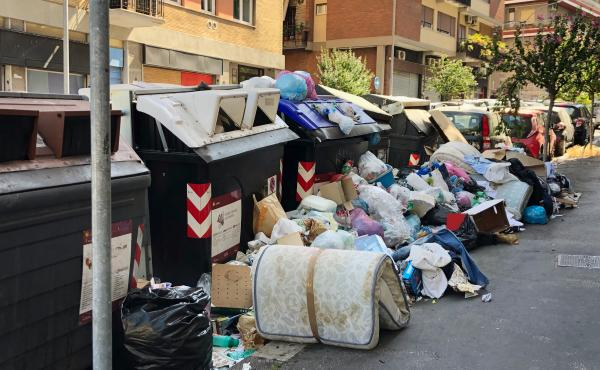 Trash piles in Monteverde, a residential neighborhood in Rome. During this scorching hot summer, the city's residents and visitors are being tested by a massive trash crisis that has prompted doctors to warn of the possible spread of diseases as birds, ve