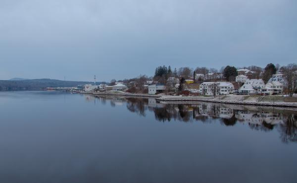 In Bucksport, Maine, the smokestack of a closed mill can be seen in this waterfront view along the Penobscot River.