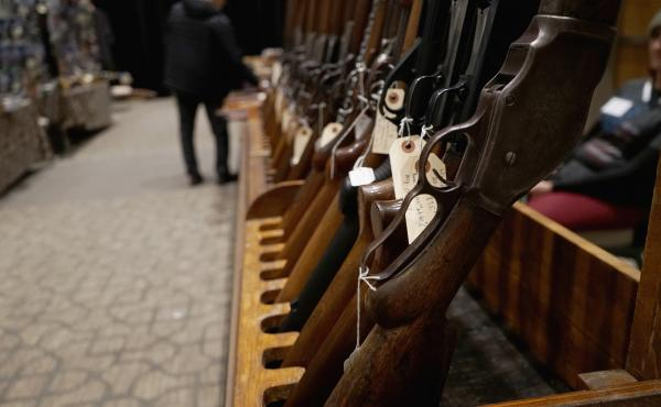 Rows of guns for sale were on display at the Vernal Knife and Gun Show in northeastern Utah, where firearms are imbued in the culture.