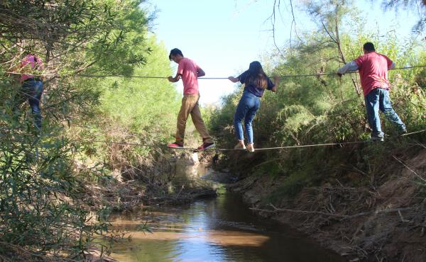 U.S. citizens use ropes to cross the Rio Grande from San Antonio del Bravo, Mexico, into Candelaria, Texas. U.S. citizens depend on the free health clinic in San Antonio del Bravo.