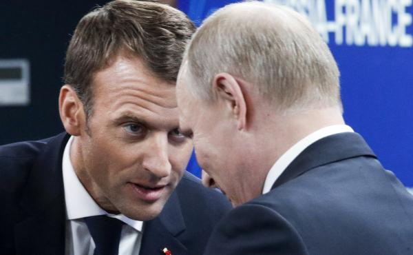 French President Emmanuel Macron (left) and Russian President Vladimir Putin attend a meeting with Russian and French business people during the St. Petersburg International Economic Forum on Friday.