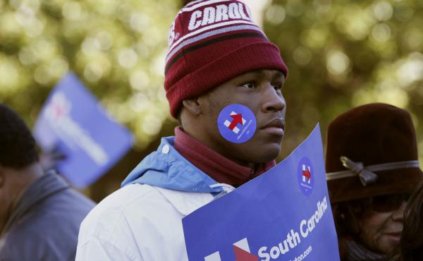 An attendee wears a Hillary Clinton campaign sticker at a rally in Columbia, S.C., last month. Young voters in Iowa and New Hampshire have helped fuel Bernie Sanders' candidacy, but as the race moves to South Carolina, a lot could change.