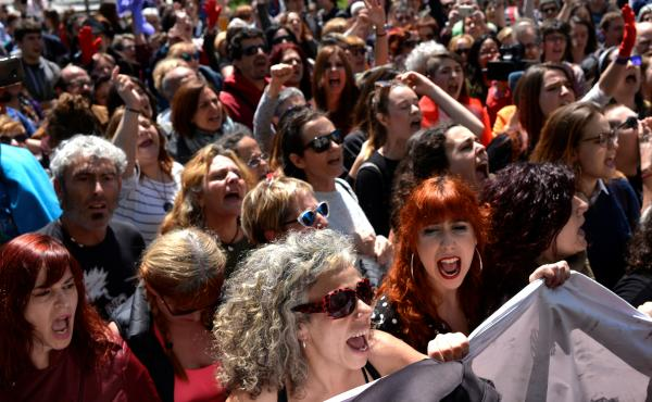 """Protesters chant """"It's not abuse, it's rape!"""" after a nine-year prison sentence was given to five men accused of the multiple rape of a woman during Pamplona's San Fermin festival in 2016."""