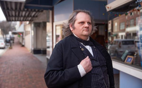 Joe Aldridge, 43, poses for a portait in his Andrew Johnson costume, a role he has played in his hometown, Greeneville, Tenn., for the past 11 years. Aldridge said he keeps his uniform in the closet of his work place, Tipton's Cafe, just in case he needs