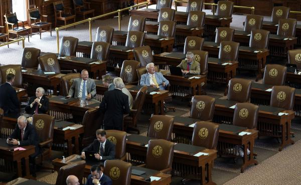 Empty seats are seen in the House Chamber at the Texas Capitol, Tuesday, July 13, 2021, in Austin, Texas. Texas Democrats left the state to block sweeping new election laws, while Republican Gov. Greg Abbott threatened them with arrest the moment they ret
