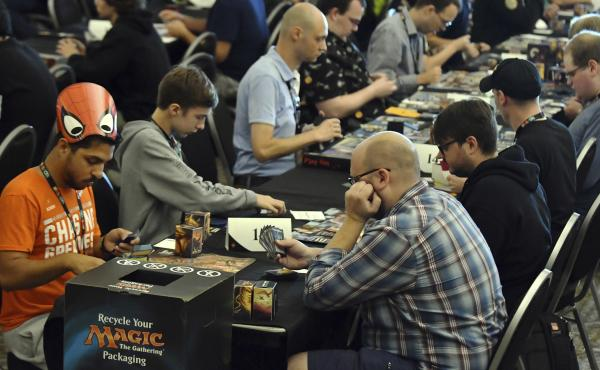 Players compete in a Magic: The Gathering tournament at Hasbro's HASCON in 2017.
