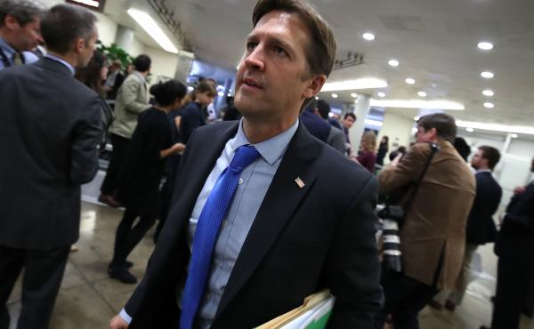Sen. Ben Sasse walks to the Senate chamber for a series of roll call votes regarding the 2018 buget on Capitol Hill on Oct. 18, 2017.