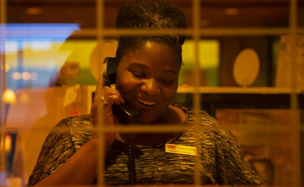 Cortez answers a call from a customer. She's earning $2,000 more a year than she made at her old job.
