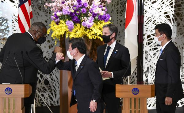 U.S. Defense Secretary Lloyd Austin, left, elbow bumps with Japan's Foreign Minister Toshimitsu Motegi, center, as Secretary of State Antony Blinken and Japanese Defense Minister Nobuo Kishi watch after a joint news conference in Tokyo Tuesday.