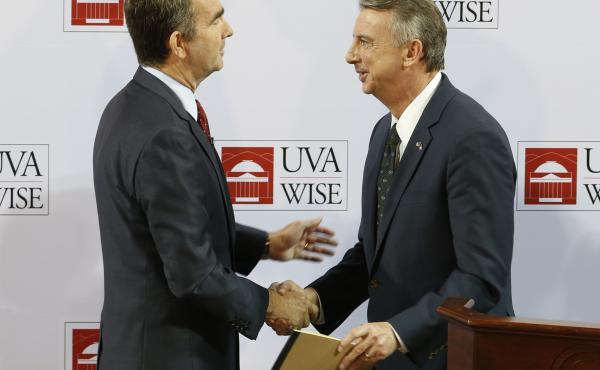 Democratic candidate for governor, Lt. Gov. Ralph Northam, (L) shakes hands with Republican challenger Ed Gillespie after a debate at the University of Virginia-Wise in Wise, Va., Monday, Oct. 9,