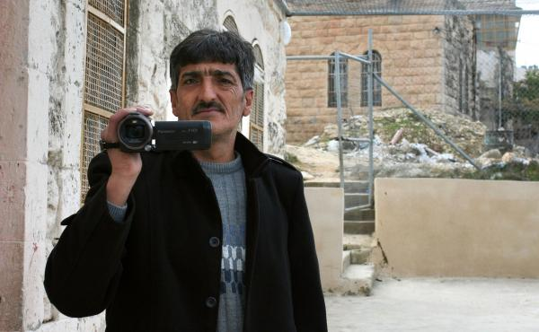 Imad Abu Shamsiyeh, a Palestinian shoemaker from Hebron, filmed an Israeli soldier shooting a badly wounded Palestinian attacker in the head last year. A military court convicted the soldier of manslaughter. Abu Shamsiyeh says he's gotten death threats fo