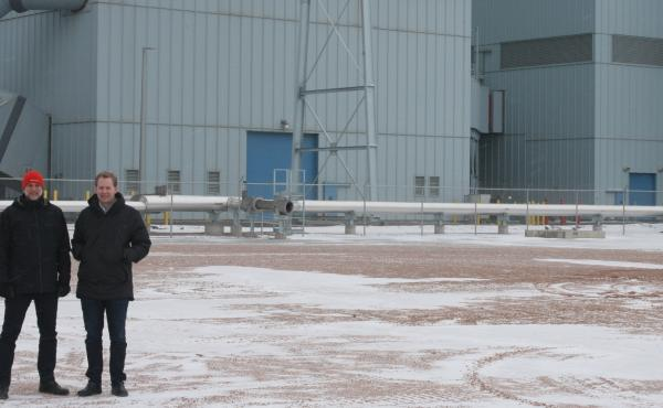 Jason Salfi, left, and Dr. David Erickson, right, of Dimensional Energy, are finalists in the Carbon XPRIZE. They stand in front of the Dry Fork Station coal-fired power plant in Gillette, Wyo., where the competition is located.