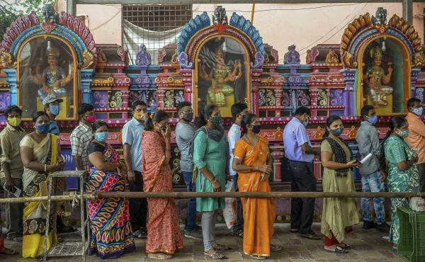 On June 25, people queued up to register for a COVID-19 vaccine at a site outside a Hindu temple in Hyderabad. Vaccinations are now being administered after a series of missteps led to a shortage of doses. If all goes well, India's public health agency ho