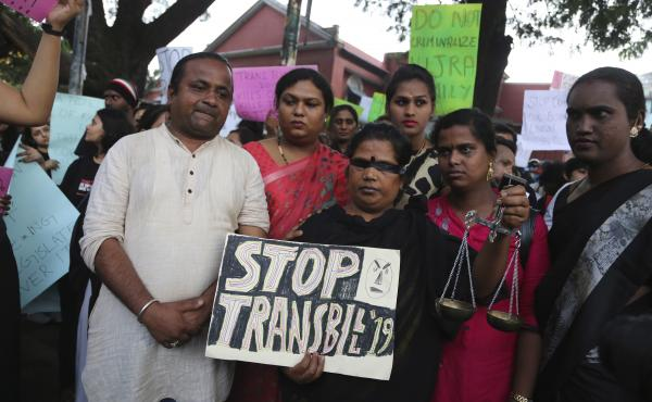 Supporters of lesbian, gay, bisexual and transgender community hold placards during a protest against passing of Transgender Persons (Protection of Rights) Bill, 2019, in Bangalore, India, Wednesday, Nov. 27, 2019. Members of the LGBT community alleged th