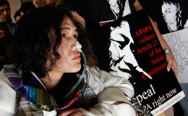 "Known as the ""Iron Lady of Manipur,"" Sharmila arrives in New Delhi in March 2013, more than 12 years into her hunger strike. She was called into a Delhi court after being accused of attempting suicide."