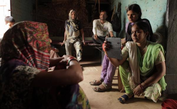 The award-winning documentary Writing with Fire follows Meera Devi (right), chief reporter for the Khabar Lahariya — a news publication run by Dalit, members of India's lowest caste.