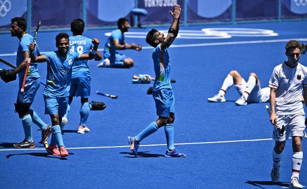 Indian field hockey players celebrate after winning the men's bronze medal match over Germany at the Tokyo Olympics.
