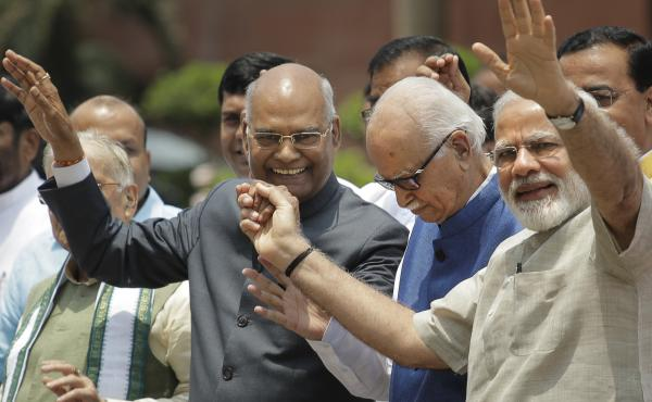Ram Nath Kovind (left) walked with Indian Prime Minister Narendra Modi (right) and Bharatiya Janata Party senior leader L.K. Advani (center) on their way to file Kovind's nomination papers for the presidential elections in New Delhi on June 23. Kovind bel