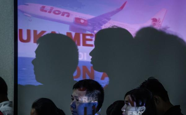 Families of victims of Lion Air Flight JT610 attend a meeting with authorities and Lion Air management on Monday in Jakarta, Indonesia. All 189 passengers and crew are feared to have died when the plane crashed shortly after takeoff on Oct. 29.