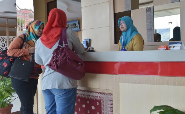 Tourists stay at a halal-friendly hotel in Bukit Tinggi, West Sumatra, Indonesia. Three Indonesian provinces have been officially listed as halal tourist destinations by Indonesia's Tourism Ministry, in a bid to increase the number of Muslim travelers fro
