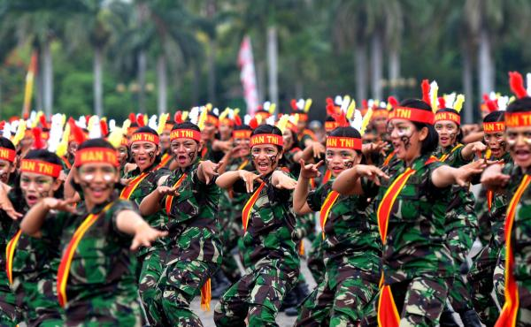 "Female soldiers perform martial arts at a ceremony in Jakarta. Women in Indonesia must undergo an invasive ""virginity test"" to join the military."