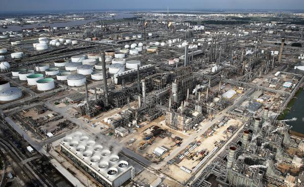 Petrochemical facilities in the Houston area are assessing their hurricane preparedness after Hurricane Harvey. This oil refinery reinforced storage tank roofs with geodesic domes —  the gray caps on some of the white tanks in the photo — to better wi