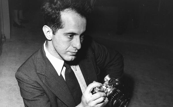 Photographer Robert Frank holds a camera in 1954. His photo book, The Americans, changed the way people saw photography and the way they saw the U.S. Frank died on Monday at the age of 94.