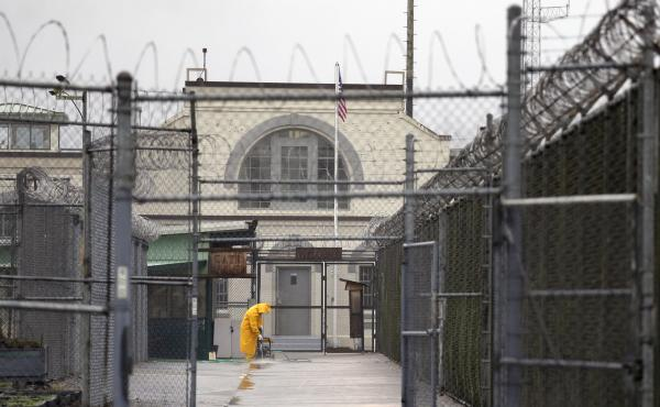 A man does maintenance work at the Monroe Correctional Complex in Monroe, Wash., in a 2016 photo. At least six inmates in a minimum-security unit of the prison have tested positive for the coronavirus.