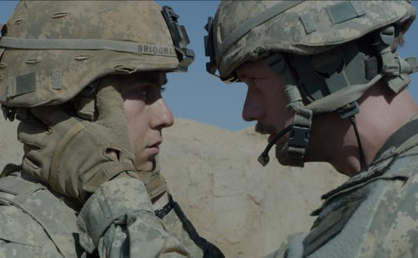 While serving in Afghanistan, a young American soldier (Nat Wolff, left) is mentally and physically tested by his commanding officer (Alexander Skarsgård, right).